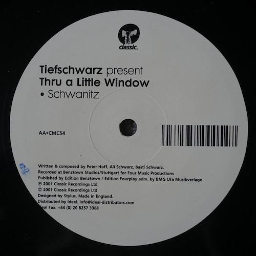 Tiefschwarz-Thru-A-Little-Window-B