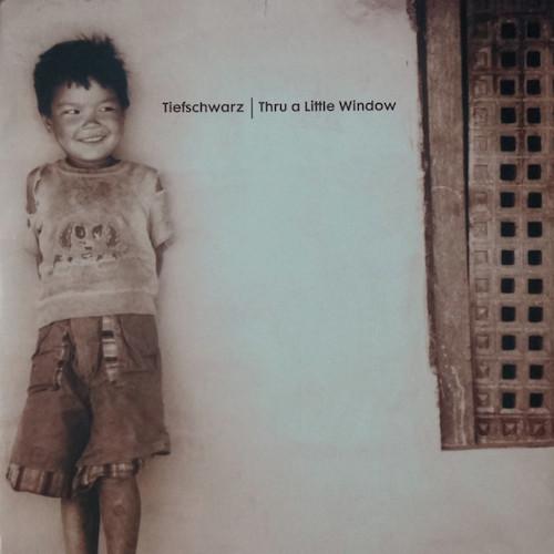Tiefschwarz-Thru-A-Little-Window-Front